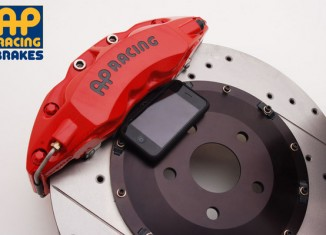 """AP Racing 16"""" Big Brake Kit for the 2010 Camaro with iphone for scale"""