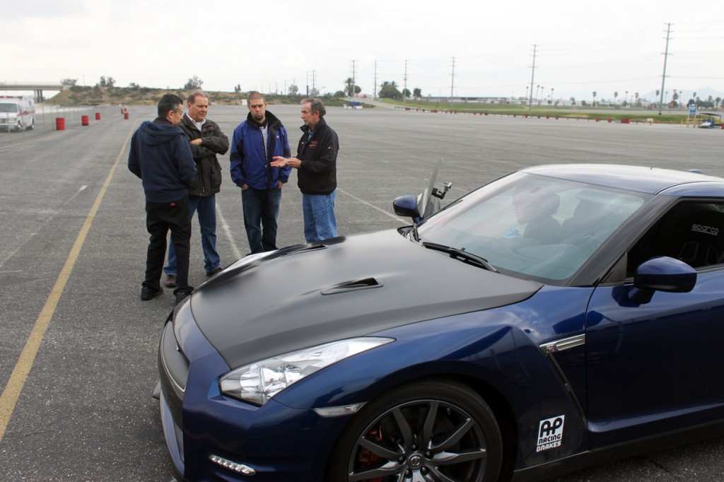 Steve Millen, Kyle Millen and other members of the STILLEN R&D team discussing the difference in brake performance