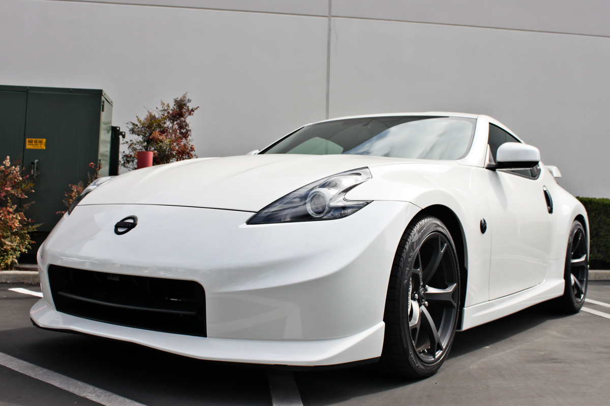 white Nisaan 370Z nismo supercharged
