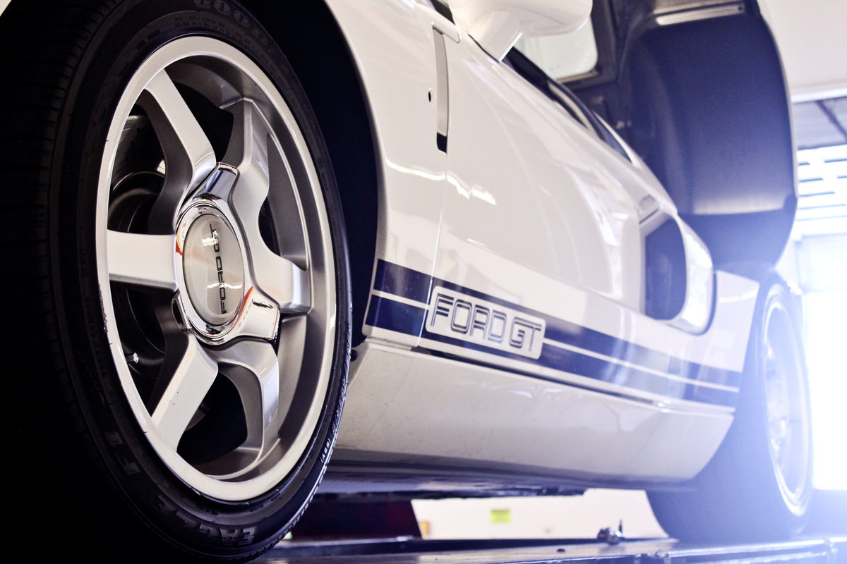 white ford gt on rack close up