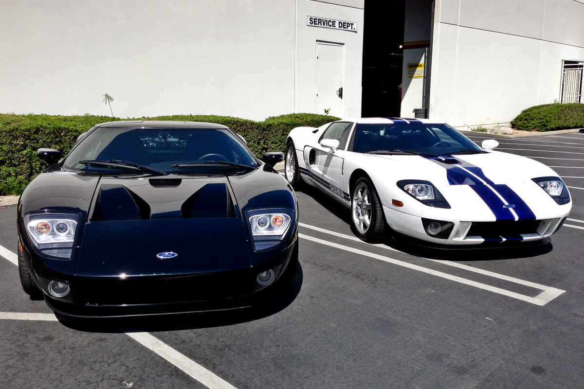 black and white Ford GTs outside service area