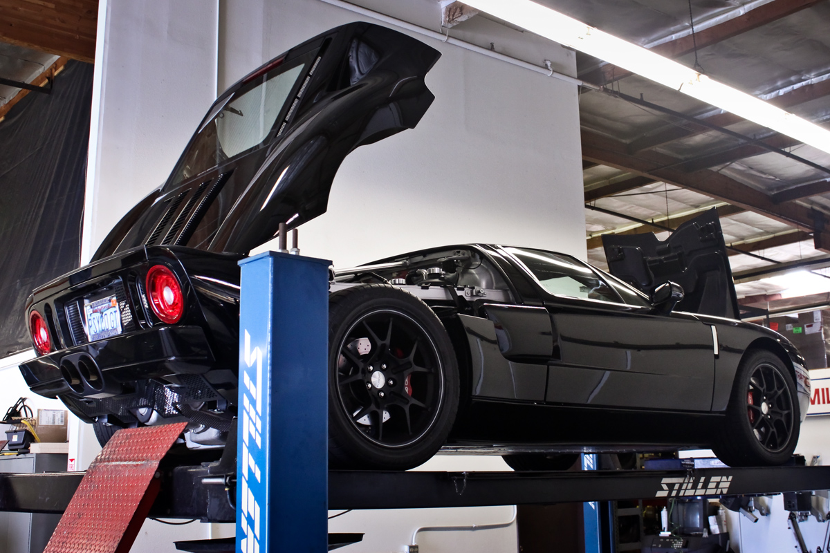 black ford gt on rack at stillen
