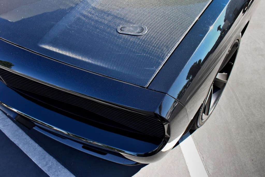 carbon fiber hood covering the magnuson supercharged challenger
