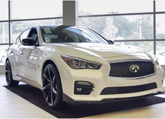 Infiniti Q50 with Lexani wheels, custom paint, Infiniti logo door lights, Infiniti rear spoiler, STILLEN exhaust, tinted windows, and smoked taillights