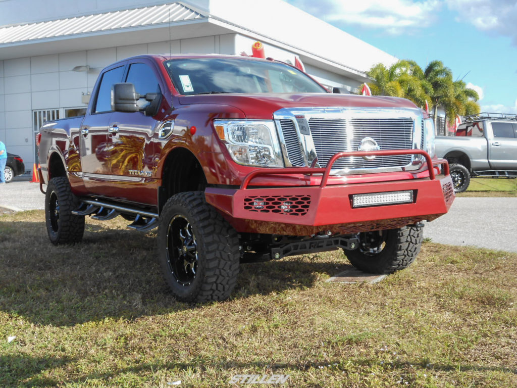 Port Charlotte Nissan Harbor Nissan - Elevating the Titan XD with Rough Country ...